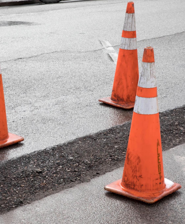 cones around new asphalt patch