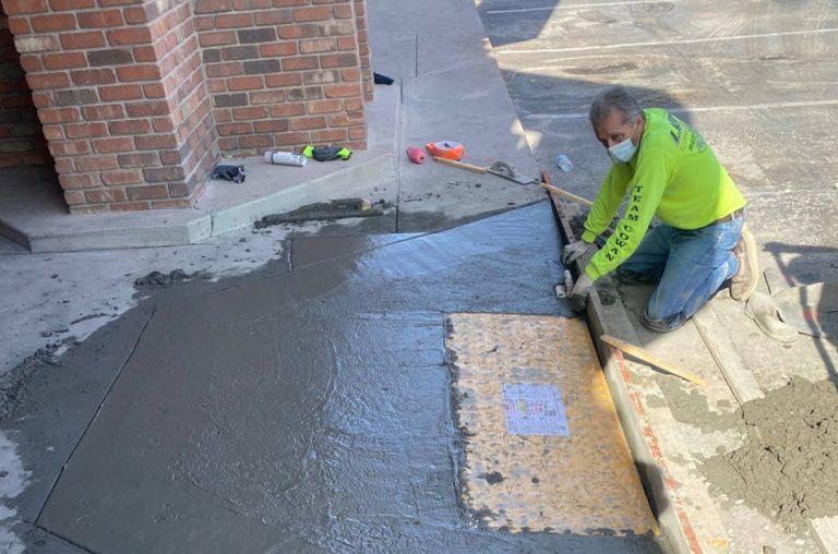 paving contractor installing concrete ada ramp in phoenix, az