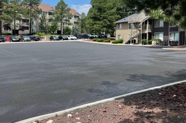 woodland village apartment parking lot after sealcoating